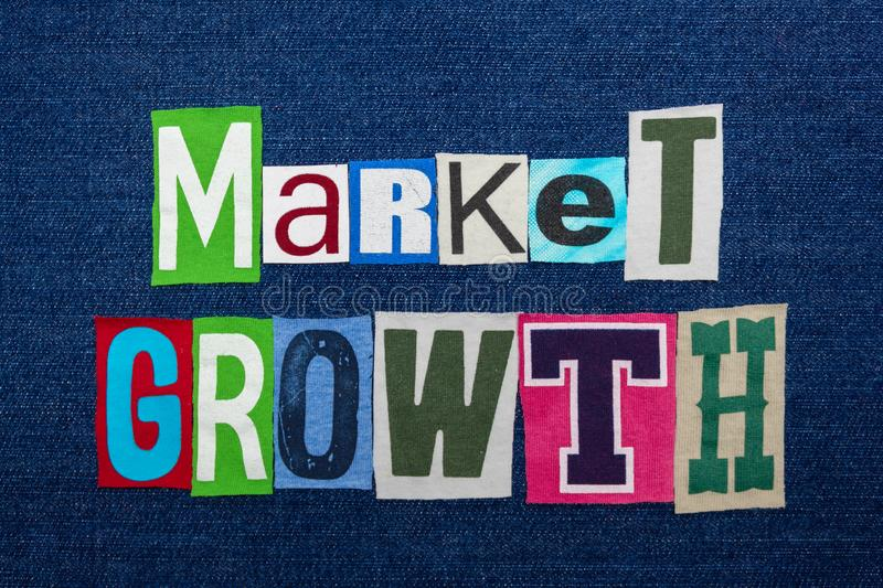 MARKET GROWTH text word collage, multi colored fabric on blue denim, expanding markets concept royalty free stock images