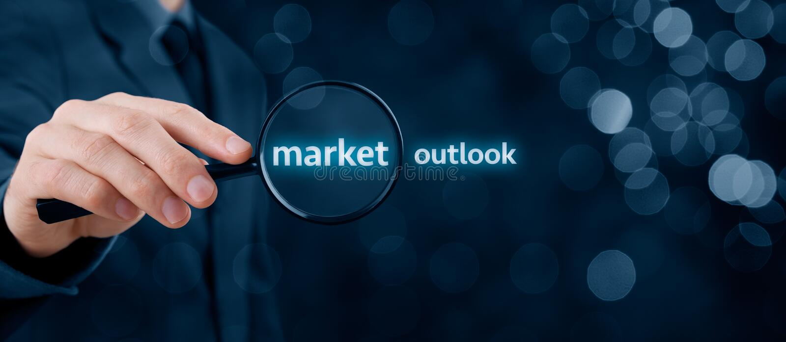 Market outlook. Concept. Businessman focused on . Wide banner composition with bokeh in background stock photos