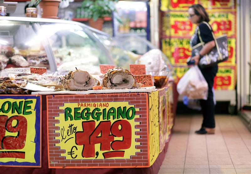 Market price Rome. Price signs display the cost in euros of italian cheese on a stall inside an indoor market in Rome, Italy stock image