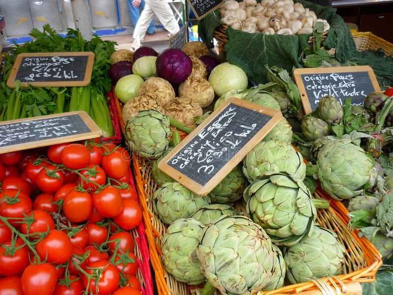 Market provence. Market stall on a typical provencal square in Nice featuring vedgetables, fish, flowers, oils and fruits stock photo