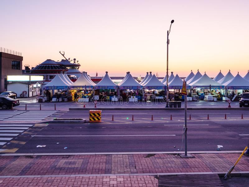 Market on quay in port in Sokcho city at dawn stock photo