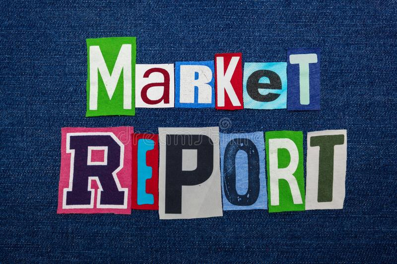 MARKET REPORT text word collage, multi colored fabric on blue denim, market situation concept. Horizontal aspect stock image