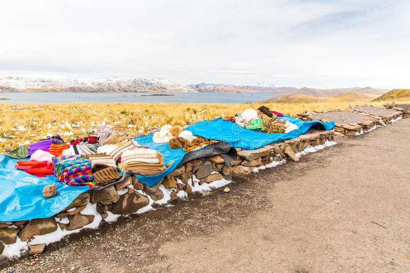 Download Market. Road Cusco-Puno Near Lake Titicaca, Peru, South America. Colorful Blanket, Cap, Scarf, Cloth, Ponchos From  Wool Of Alpa Royalty Free Stock Photography - Image: 33740207