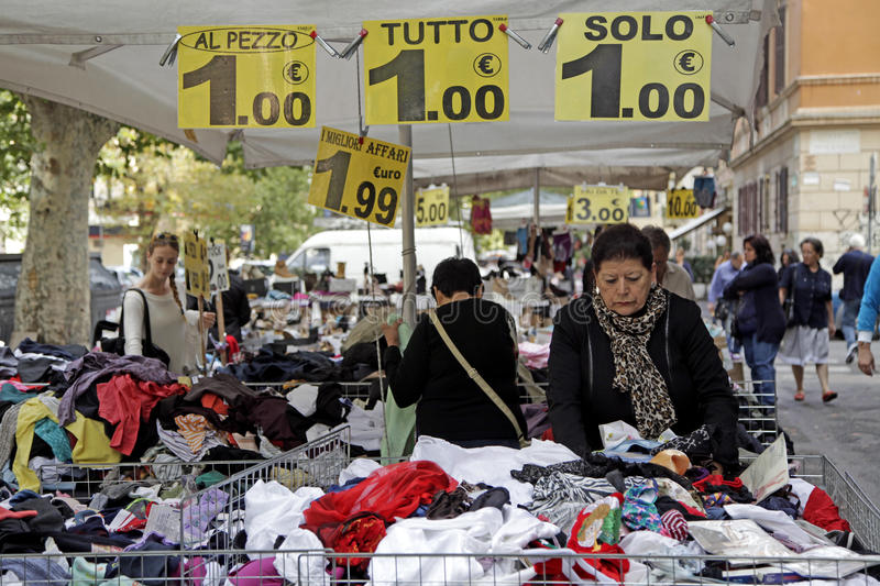 Market Rome. Price signs display the cost in euros of clothes on a stall at an outdoor market in Rome, Italy royalty free stock images