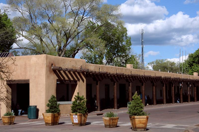 Adobe homes and shops in Santa Fe with covered gallery for the local market in the shade royalty free stock photo