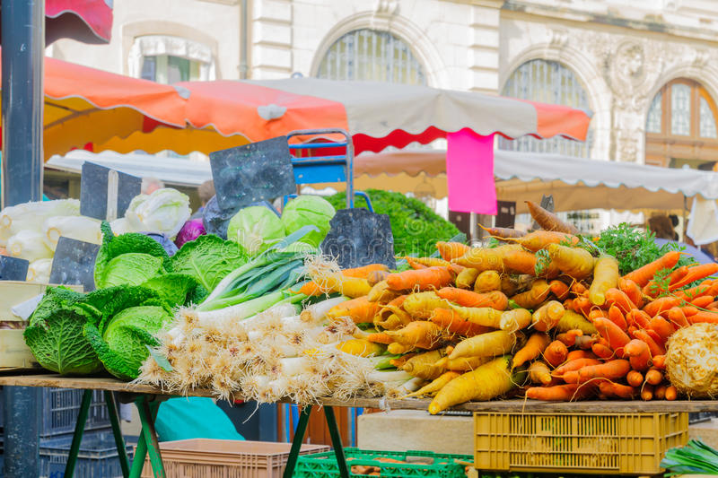 Market scene in Beaune. Carrots and other vegetables on sale in the market, in Beaune, Burgundy, France royalty free stock photo