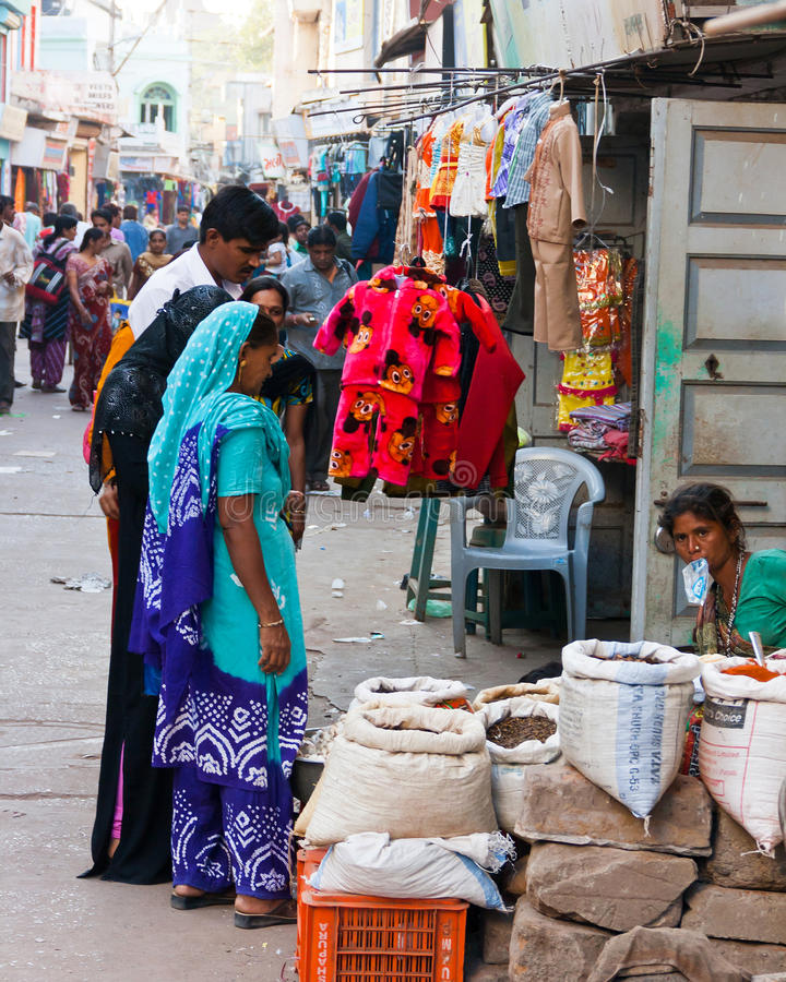 Market scene in India. Family mulling over a purchase in this crowded market street in the city of Bhuj, India. The Gujarat Earthquake of January 2001 destroyed stock photos