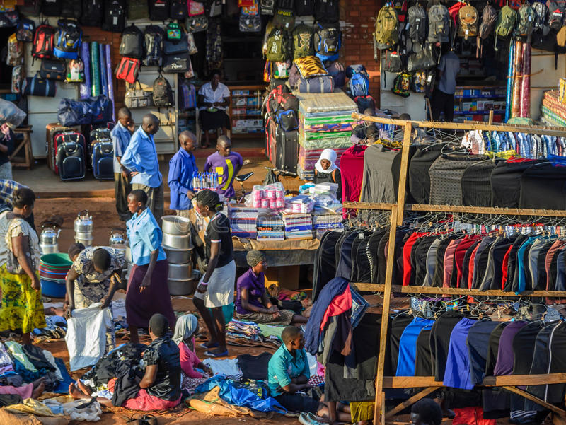 Market scene. Jinja, Uganda -September 2015 - A clothes market scene in downtown Jinja. Most of the clothes sold in this market are Chinese mad counterfeit stock photo