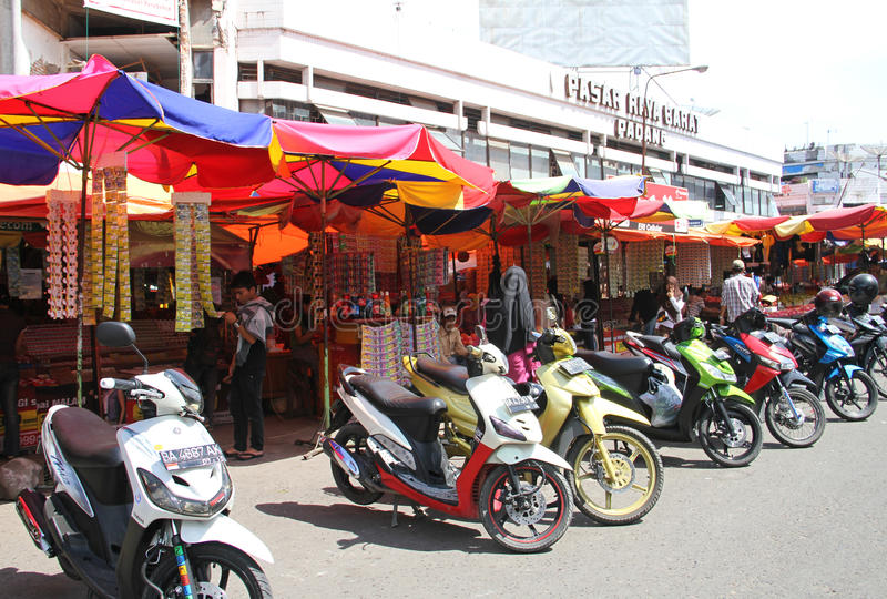 Market Scene in Padang, Indonesia. Market stalls and motorbikes in Padang City, West Sumatra, Indonesia royalty free stock photos