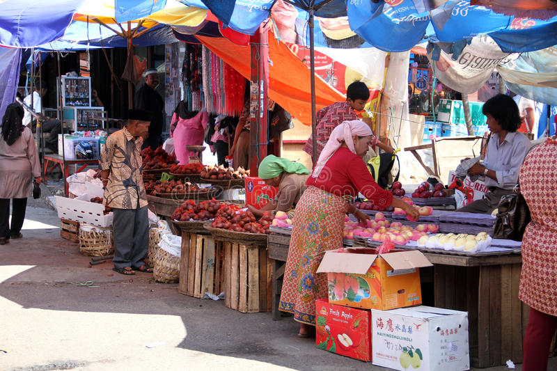 Market Scene in Padang, Indonesia. Market stalls and motorbikes in Padang City, West Sumatra, Indonesia royalty free stock photo
