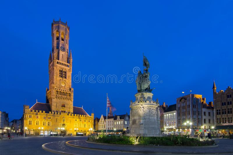 Market square and Belfort tower at night, Bruges, Belgium stock photography
