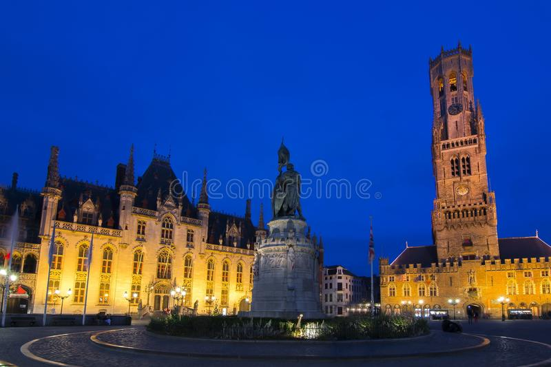 Market square and Belfort tower at night, Bruges, Belgium stock images