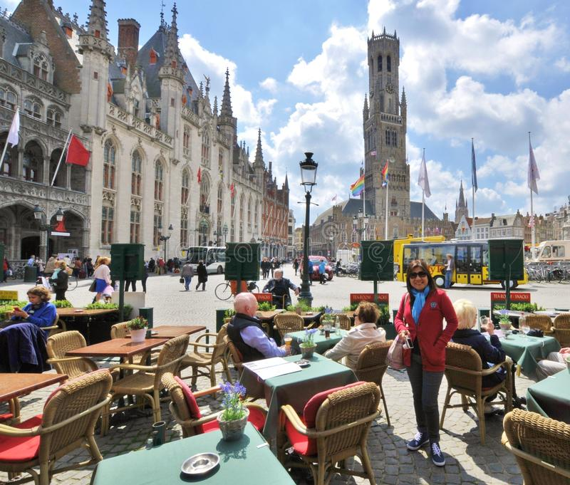 Market Square, Bruges. Market Square in Bruges, Belgium. Background is the Palace and the Belfort stock images