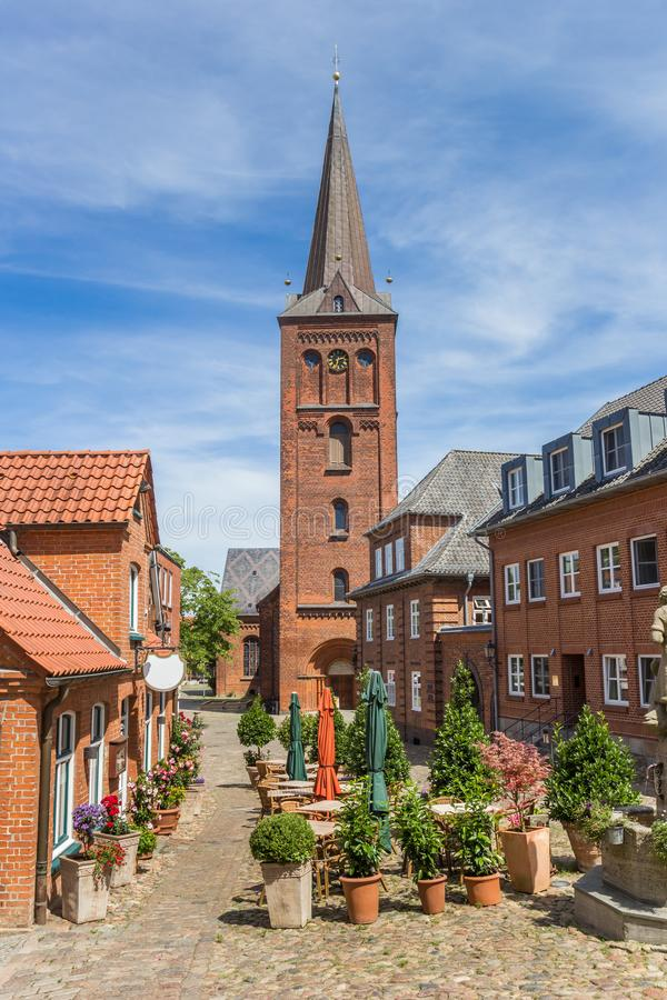 Market square and church tower in Plon. Germany royalty free stock photography