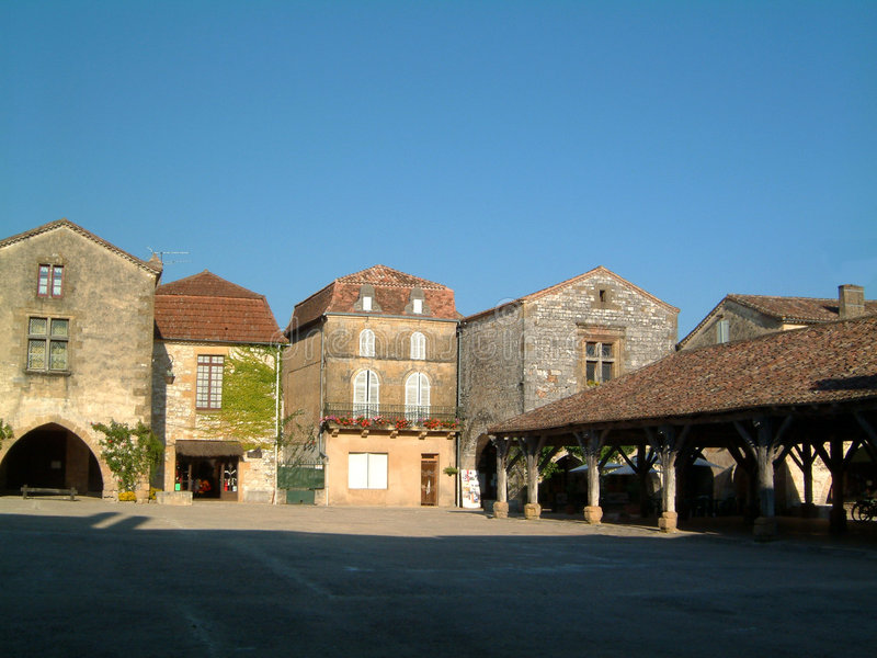 Market Square evening 1. Market square in Monpazier, France, on a summers evening stock image
