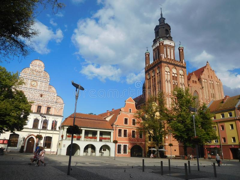 The Market Square in Stargard Szczecinski, Poland. View of the restored Market Square with the townhall facade and the gothic cathedral stock images