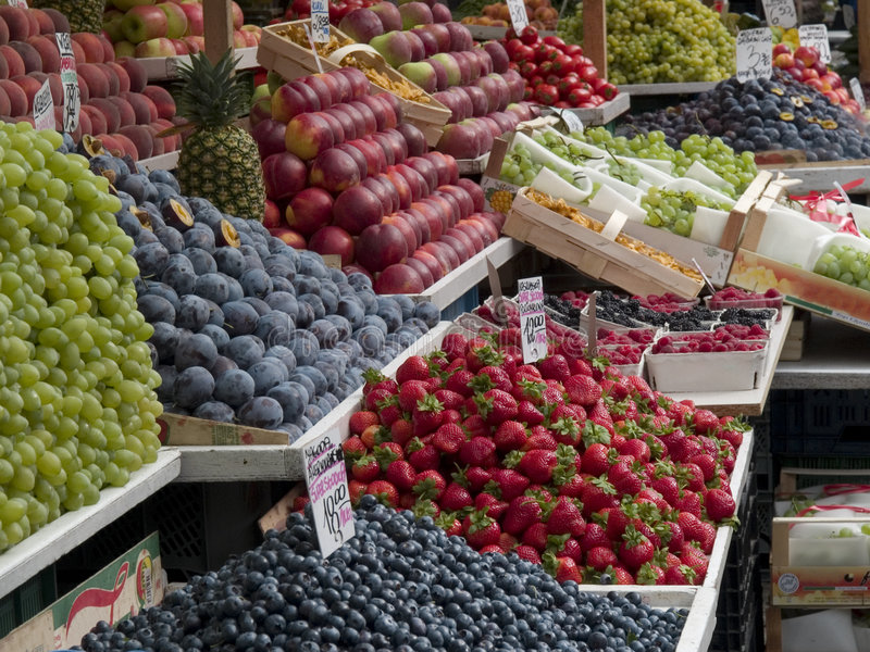 Market stall. Pile of fresh fruits on a market stall stock photography