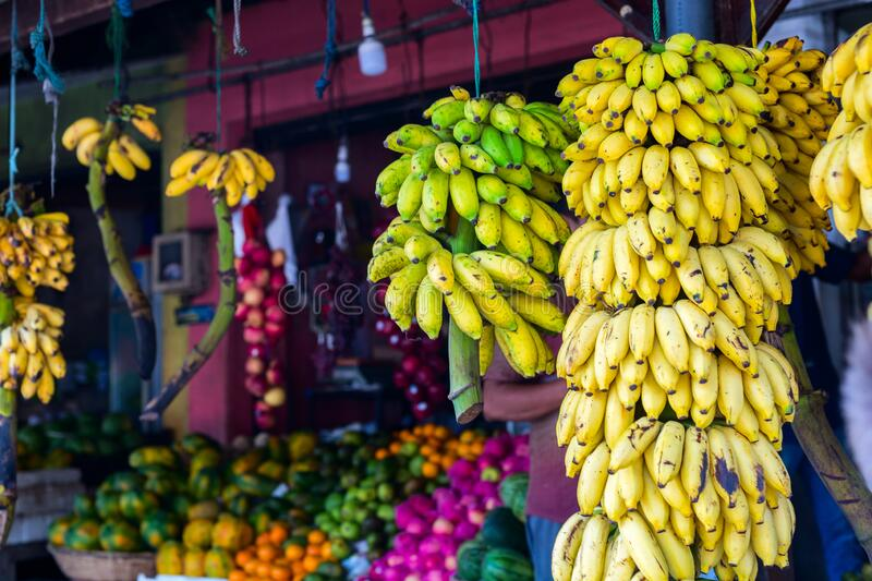 Market stall. With bananas and other fruits royalty free stock photo