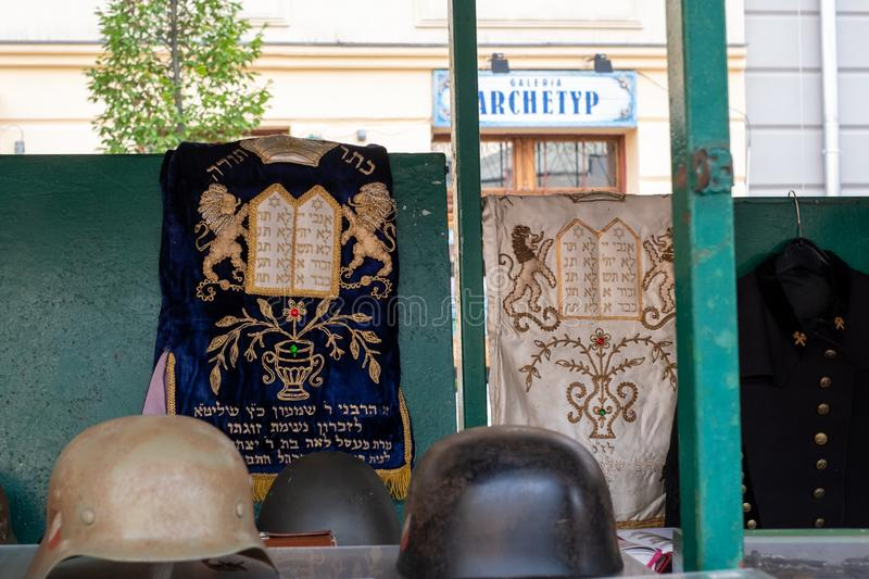 Market stall catering to tourists, selling Judaica and vintage items of Jewish interest, in Plac Nowy, Kazimierz, Krakow Poland. Market stall catering to royalty free stock image