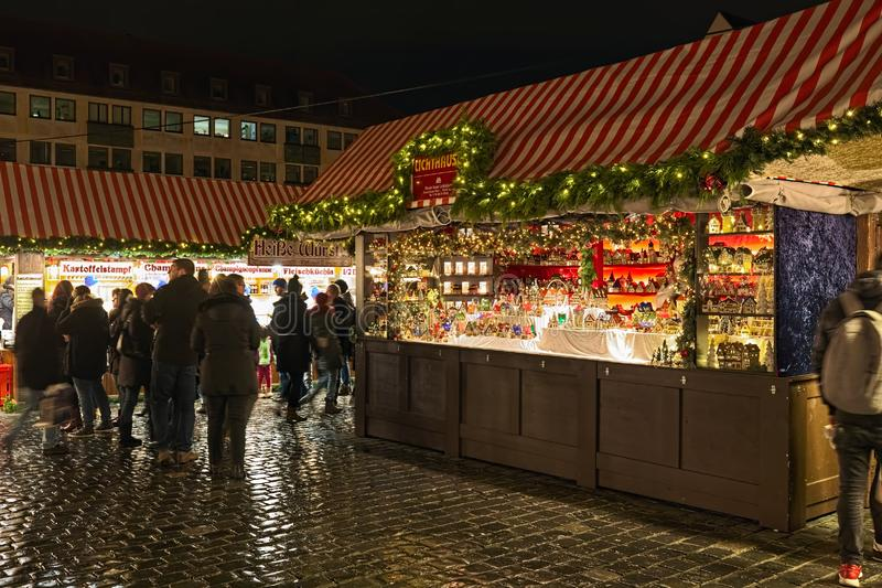 Market stall with miniature Christmas light houses at the Christmas market in Nuremberg, Germany stock images