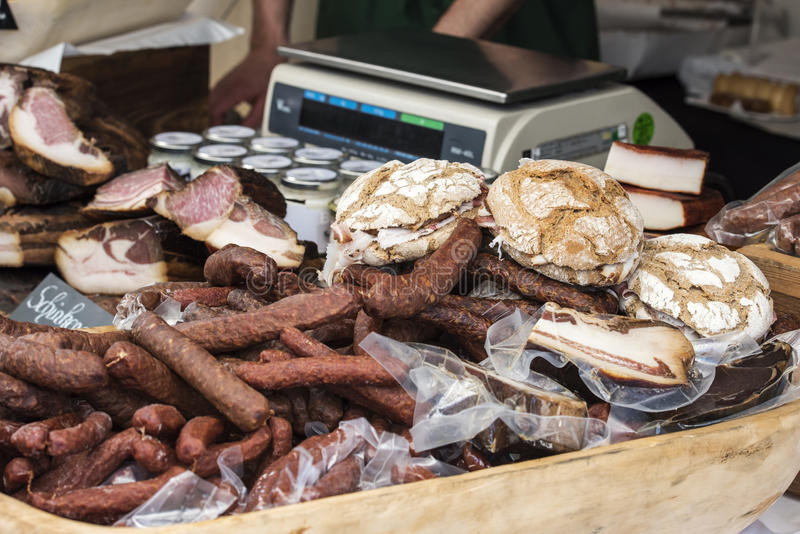 Market stall. Sausage and bacon in the market stall sell royalty free stock images