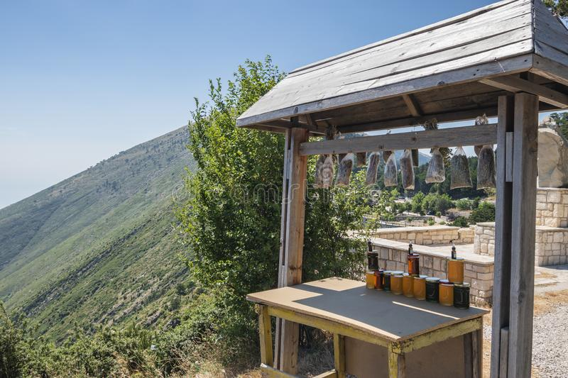 Market stall selling local honey, tea and spices at Llogara National Park. Vlore, Albania - July, 2019: View of a market stall selling local honey, tea and stock photos