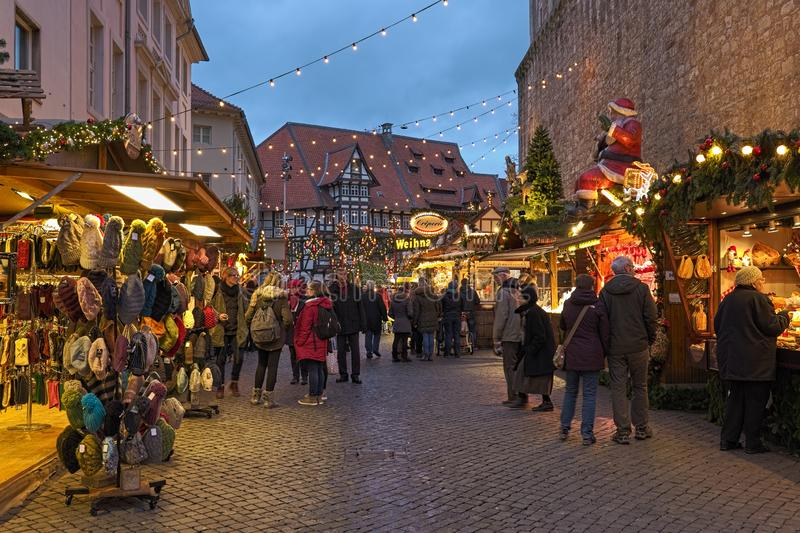 Market stalls close to Brunswick Cathedral at Christmas market in Braunschweig, Germany. Braunschweig, Germany. Market stalls with Christmas presents, wool royalty free stock image