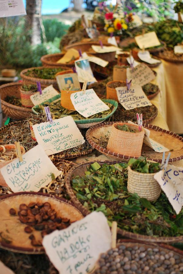 Market stand with spices and herbes in saint paul reunion island stock images