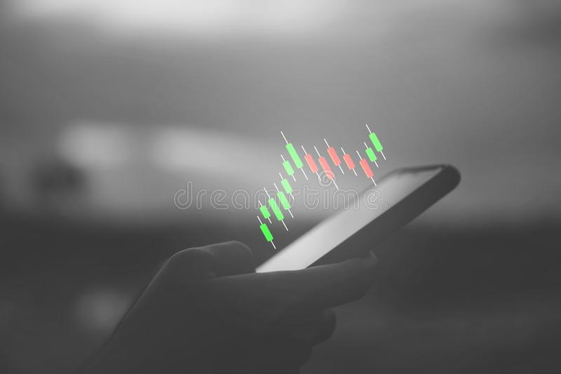 Market stock graph icon screen of smartphone background. Financial business technology freedom dream life using internet freedom stock photos
