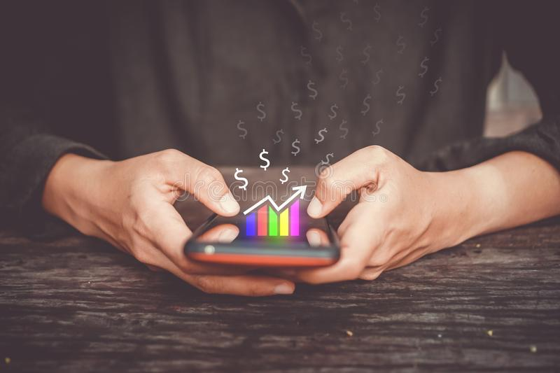 Market stock graph icon screen of smartphone background. Financial business technology freedom dream life using internet freedom royalty free stock images