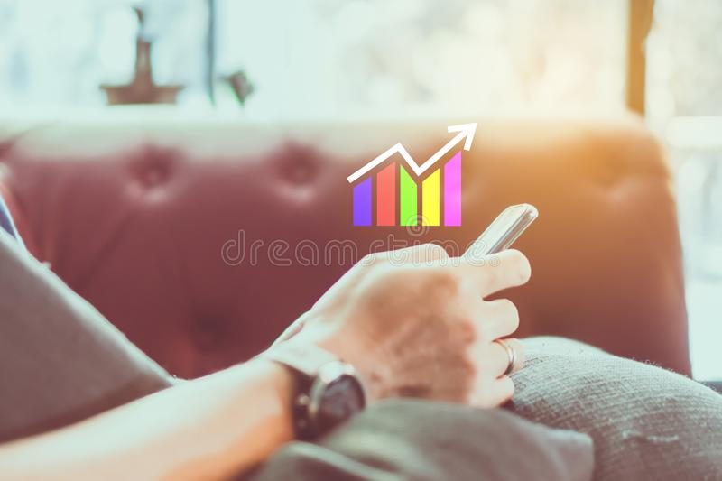 Market stock graph icon screen of smartphone background. Financial business technology freedom dream life using internet freedom stock images
