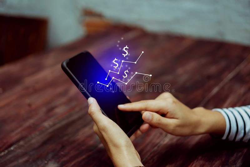 Market stock graph icon screen of smartphone background. Financial business technology freedom dream life using internet freedom stock photo