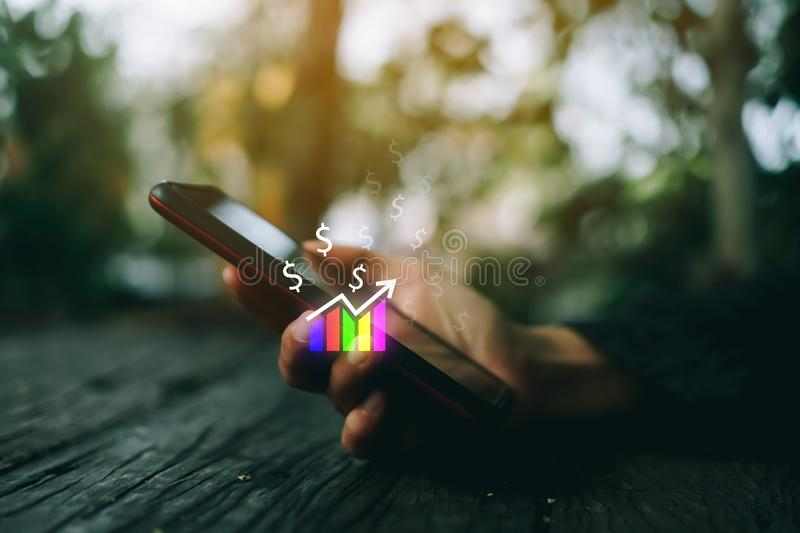 Market stock graph icon screen of smartphone background. Financial business technology freedom dream life using internet freedom royalty free stock photography