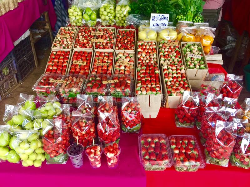 Market. Strawberry and fruit sell in market stock images