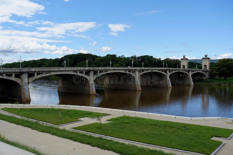 Distinguished Concrete Arch Bridge. Market Street bridge over the Susquehanna River connecting Wilkes-Barre to Kingston on the far side in northeast Pennsylvania royalty free stock image