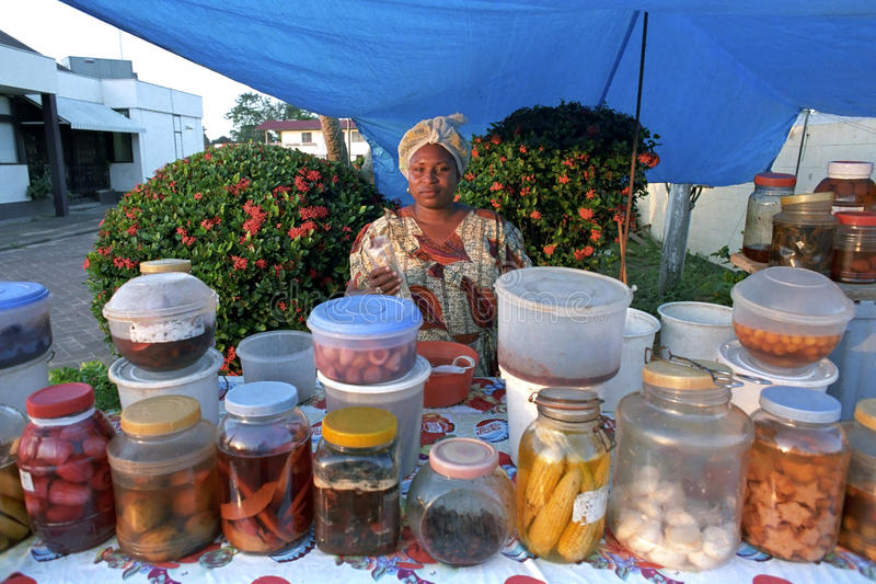 Market Tradeswoman in her market stall stock image