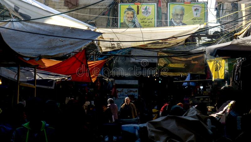 Market under the poster of Yasser Arafat in Sabra and shatila refugee camp in beirut Lebanon royalty free stock images