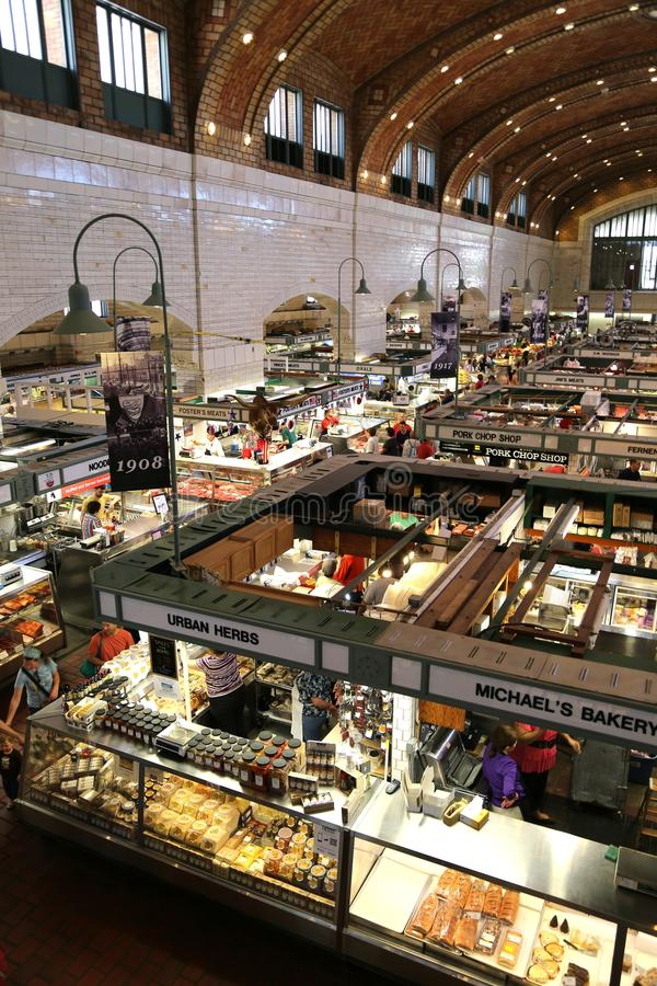 Market vendors. Shopper's visit Meat and produce vendors at the indoor shopping market. West Side Market in the Ohio City neighborhood, Cleveland, Ohio stock photography