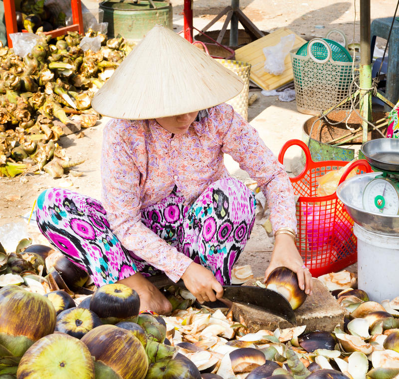 Market women preparing nata de coco. Locals buy their daily needs from local open air markets, rather than large grocery stores. Here a woman is preparing nata stock photos