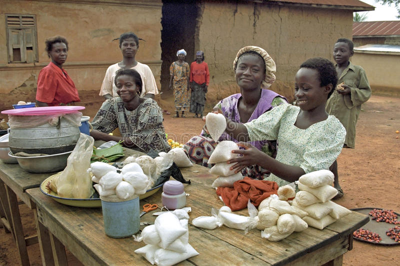 Market Women with their merchandise. Ghana, village Forikrom: group portrait of young Ghanaian market women, woman. They sell rice, herbs and chestnuts [sell stock photography