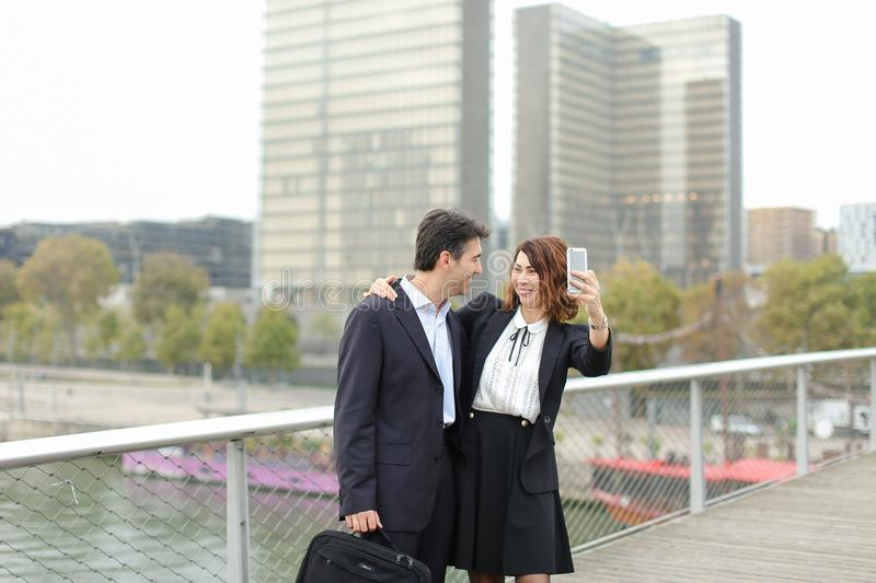 Marketer man and HR manager woman using smartphone taking sel royalty free stock photography