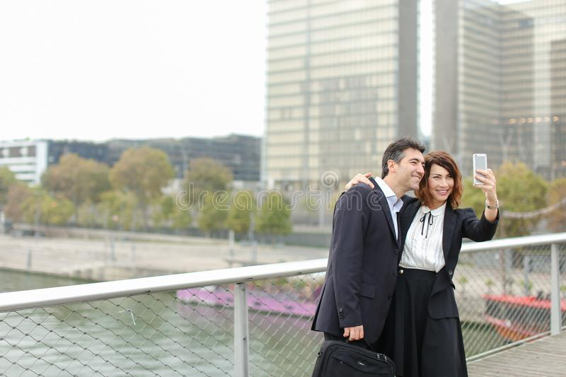 Marketer man and HR manager woman using smartphone taking sel royalty free stock photo