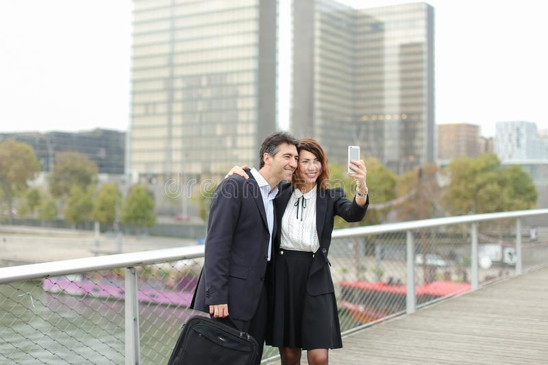 Marketer man and HR manager woman using smartphone taking sel royalty free stock image