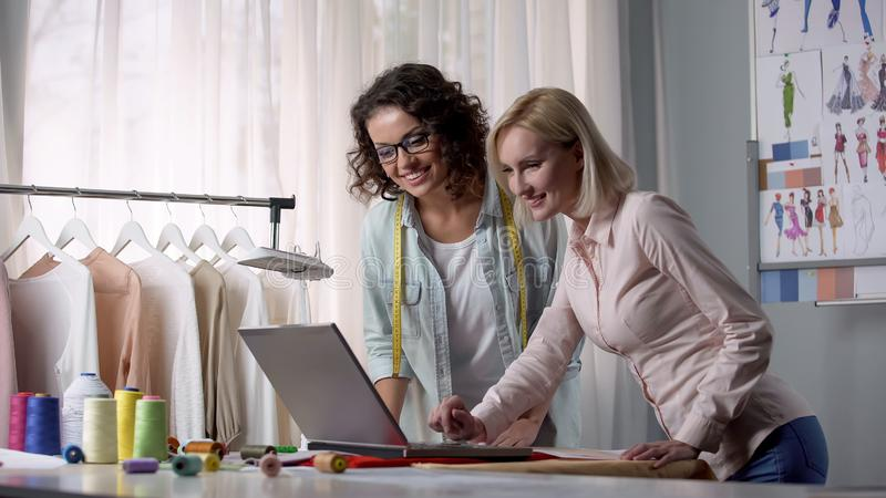Marketer showing new software facilitating creation of patterns and drawings stock photos