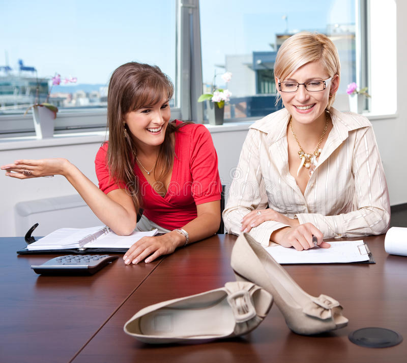 Marketing. Young businesswomen discussing marketing of a new shoe product stock image