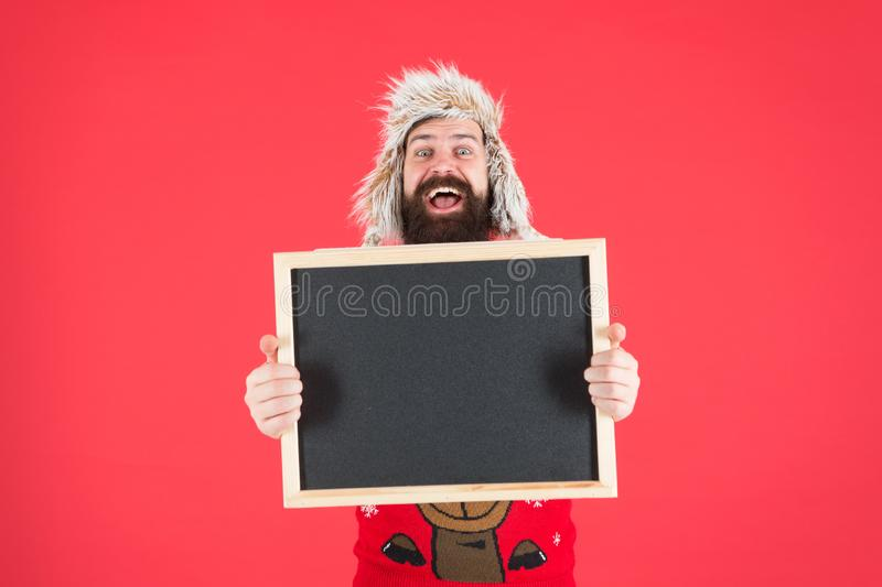Marketing and advertising. Happy hipster hold empty blackboard. Bearded hipster in winter wear. Hipster with mustache stock images