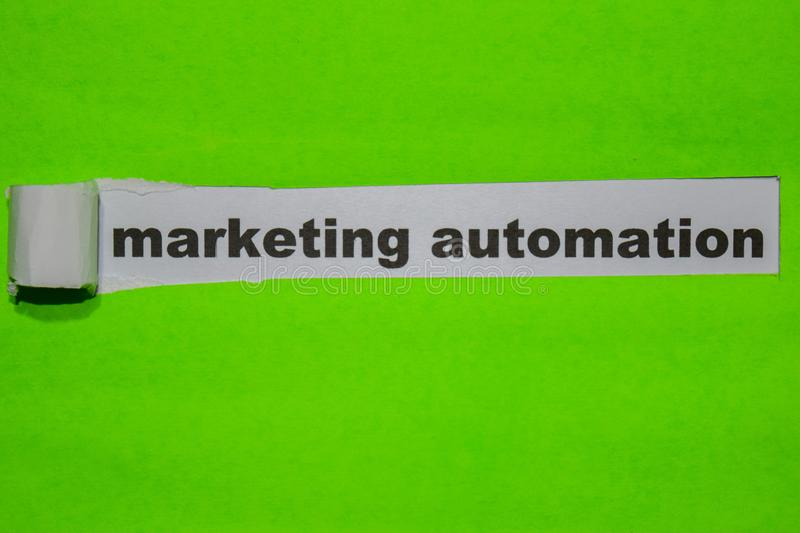 Marketing Automation, Inspiration and business concept on green torn paper stock image