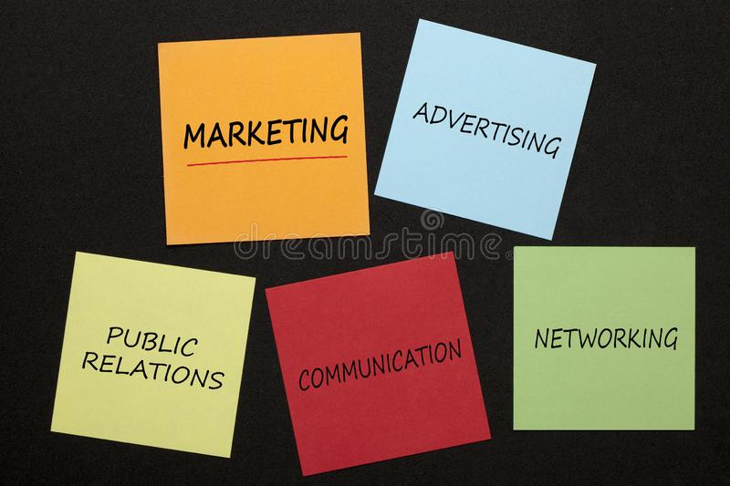 Marketing Communications Concept. Marketing with keywords written in colorful notes on black background. Methods of communicating royalty free stock photography