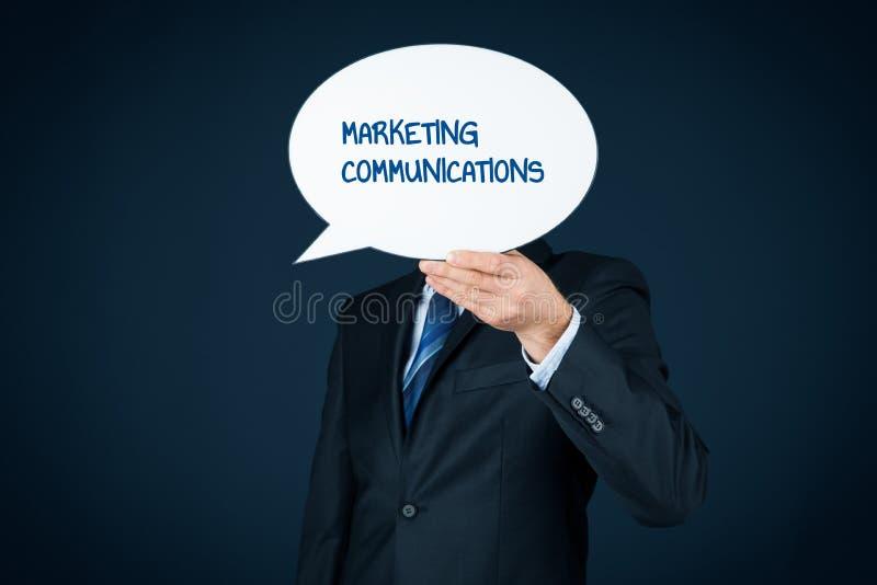 Marketing communications concept. Marketing specialist with marketing communications text on speech bubble royalty free stock photo