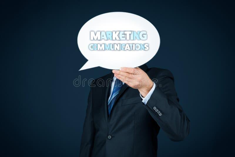 Marketing communications concept. Marketing specialist with marketing communications text on speech bubble royalty free stock image